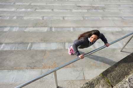 warming up: Urban fitness woman doing push ups exercise workout for warming up and strength training. Stock Photo