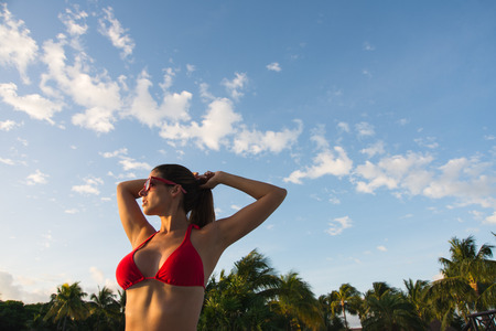 Relaxed beautiful woman on summer vacation at resort or tropical beach. Tranquility and relax in the morning during caribbean travel. Stock Photo