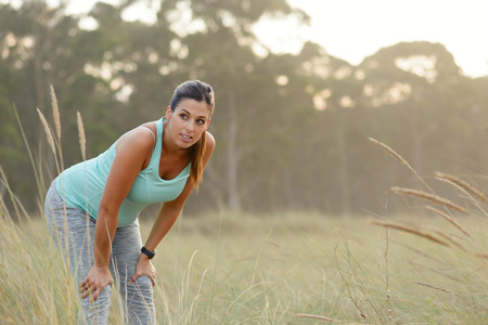 Pregnant sporty woman taking a fitness workout rest. Healthy pregnancy active lifestyle outdoor. Фото со стока