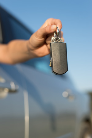 drive car: Close up of woman holding car keys. New vehicle and driving concept. Stock Photo