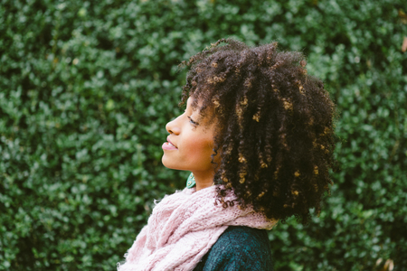 Profile portrait of black woman with afro style hair in autumn. Banco de Imagens