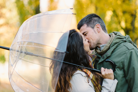 lovely young couple kissing in autumn at the park romantic man