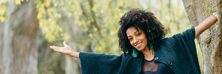 Autumn lifestyle and fashion concept banner. Stylish young black woman smiling. Stock Photo