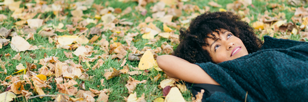 Banner of young black happy woman relaxing in autumn. Happiness and relax concept.