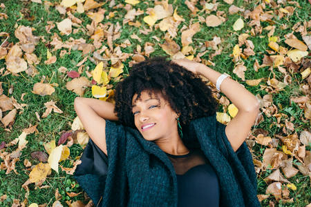 Young black happy woman relaxing in autumn. Happiness and relax concept. Stock Photo