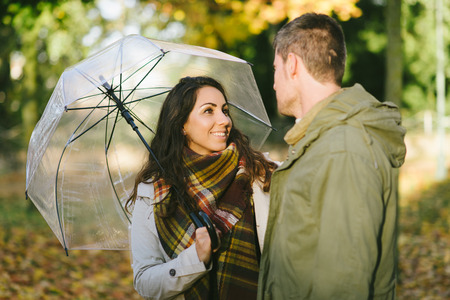 Cute couple of lovers in autumn outdoor. Love and caring relationship concep.