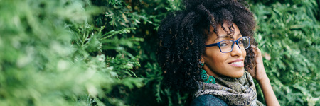 Beautiful black woman wearing eye glasses banner. Fashion and eyewear concept. Archivio Fotografico