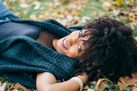 Young black happy woman relaxing in autumn. Happiness and relax concept. 免版税图像