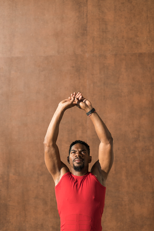 Young fit man stretching arms. Banco de Imagens