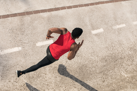 Top view of young black man running in the city,