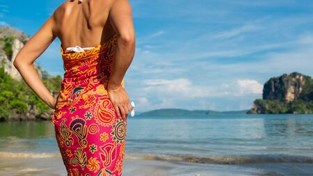Detail of woman on travel vacation to Railay Beach, Thailand.