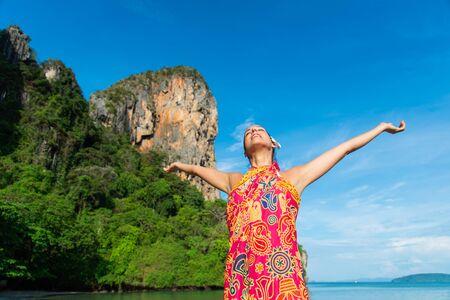 Woman enjoying freedom and leisure at beautiful Railay Beach, Thailand.