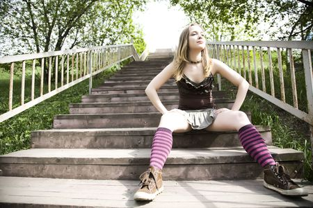 Lady Sitting On Wooden Stairs Stock Photo - 3019252