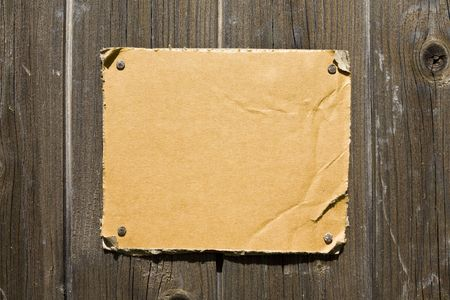 Torn Cardboard On Wooden Wall. Ready For Your Message. Stock Photo - 3159797