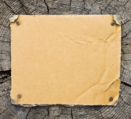Torn Cardboard On Wooden Background Stock Photo - 3159766