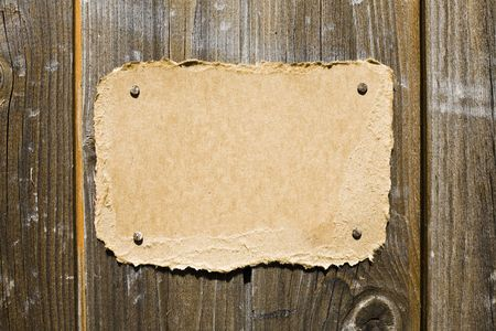 Torn Cardboard On Wooden Wall. Ready For Your Message. Stock Photo - 3159802