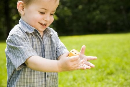 Happy Childhood.  Boy Playing Outdoors. Stock Photo