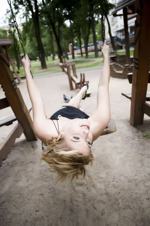 Young Woman On The Swing photo