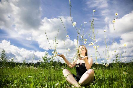 Daisy Rain. Woman Playing With Flowers. photo