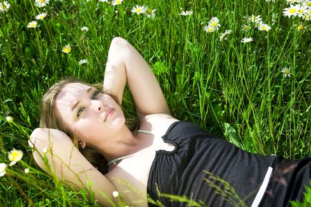 woman laying: Young Beautiful Woman Laying On The Grass Stock Photo