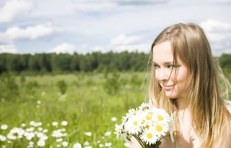 Smiling Woman With Flowers Outdoors Stock Photo - 3281939