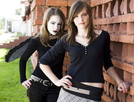 Two Teenager Girls Near The Brick Wall photo
