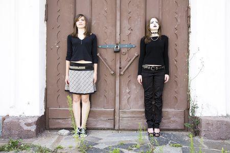 antipode: Antipode. Two Teenagers Against Wooden Door.