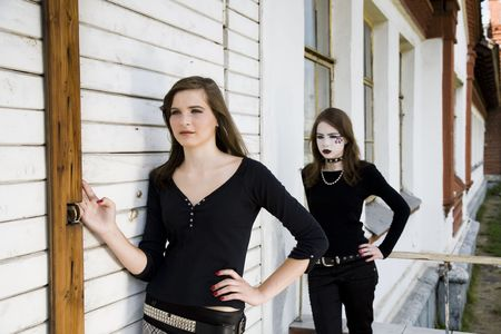 Two Teenagers Against Wooden Wall photo