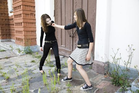 fetish wear: Teen Slavery. Two Teenagers Near The Old Wall. Stock Photo