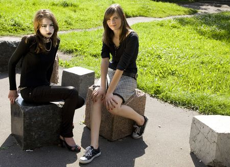 Teenagers Culture. Two Girls Outdoor. photo
