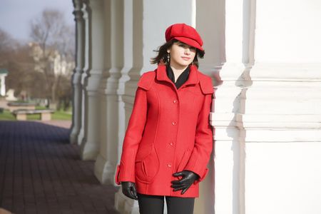 Girl Dressed In Red Coat And Cap photo