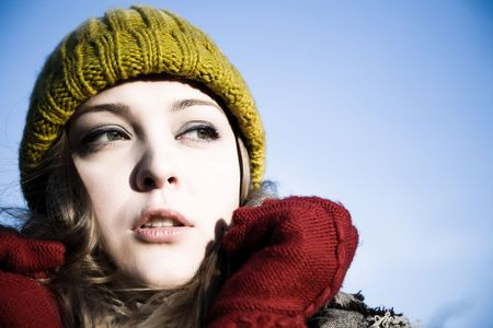 expressing: Young Model Woman In Green Hat Outdoors Stock Photo