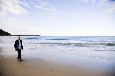 Man On The Beach. San Sebastian. Spain photo