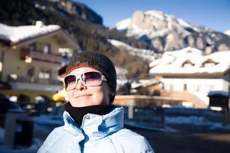 Happy Woman In Small Italian Alps Village. Winter Travel Series. photo
