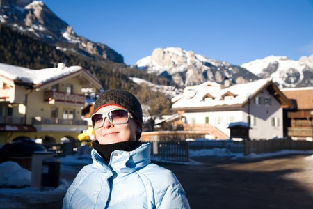 Young Woman In Alps Resort. Winter Travel Series. photo