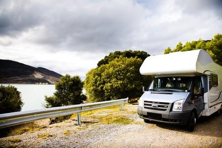motorhome: Motor Home On Gravel Road Against Nature Background