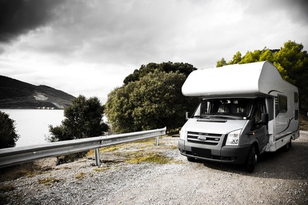 Motorhome Parking On The Gravel Road Near The Lake Stock Photo