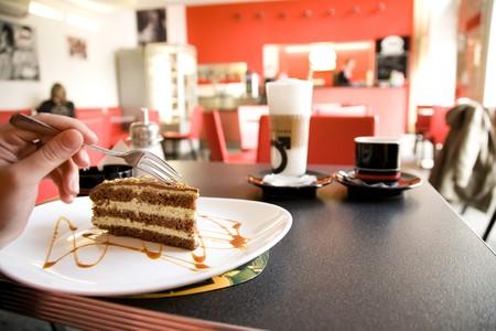 coffee spoon: Woman Eating Cake In One Of Prague Coffee Shop