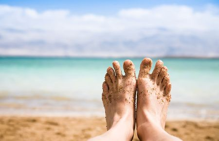 View of Bare Feet with a Backdrop of the Dead Sea photo
