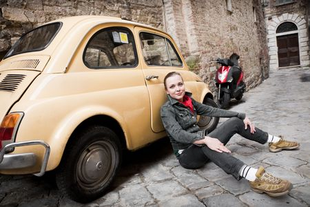 filthy: Beauty Woman Against Retro Car On The Old Street.  Stock Photo