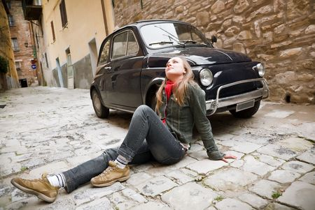 italian PEOPLE: Beauty Woman Sitting Against Retro Car. Old Italy Series. Stock Photo