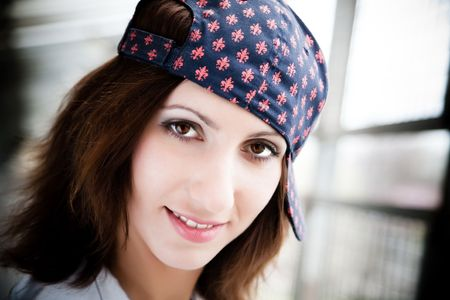 Dark Haired Girl With Baseball Cap. Close-Up Portrait photo