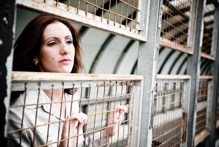 Pretty Woman Close-Up Portrait. Behind An Iron Lattice Stock Photo - 4819910