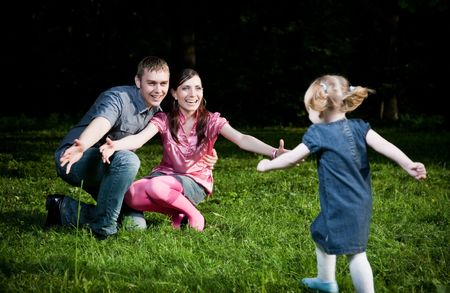 Happy Family Playing On The Grass photo