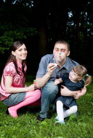 Father Blowing Soap Bubbles. Family Portrait. Stock Photo - 5076441
