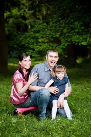 Happy Family In The Summer Park photo