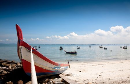 fishing scene: Fisher On The Beach Under The Blue Sky. Penang Collection
