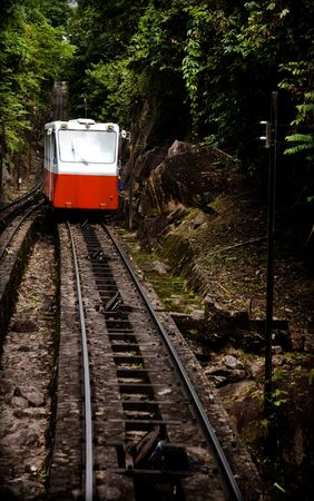 traditional climbing: Mountain tram going through the jungle. Penang collection. Stock Photo