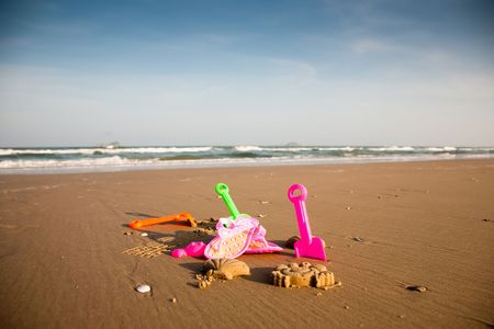 colrful: Colrful children toys on the beach. Childhood collection.