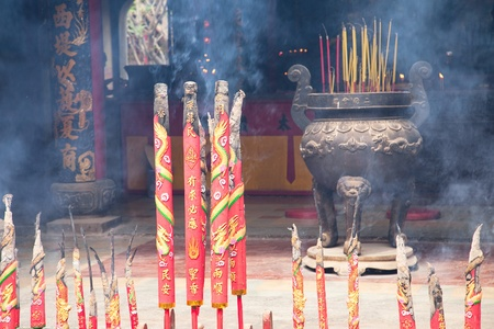 Chinese Temple filled with smoke from burning incenses. New Year's Eve. Ho Chi Minh, Vietnam Stock Photo - 9125006